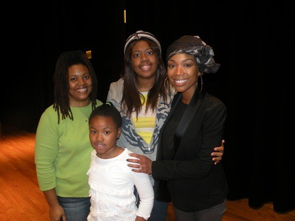 Brandy Norwood and students